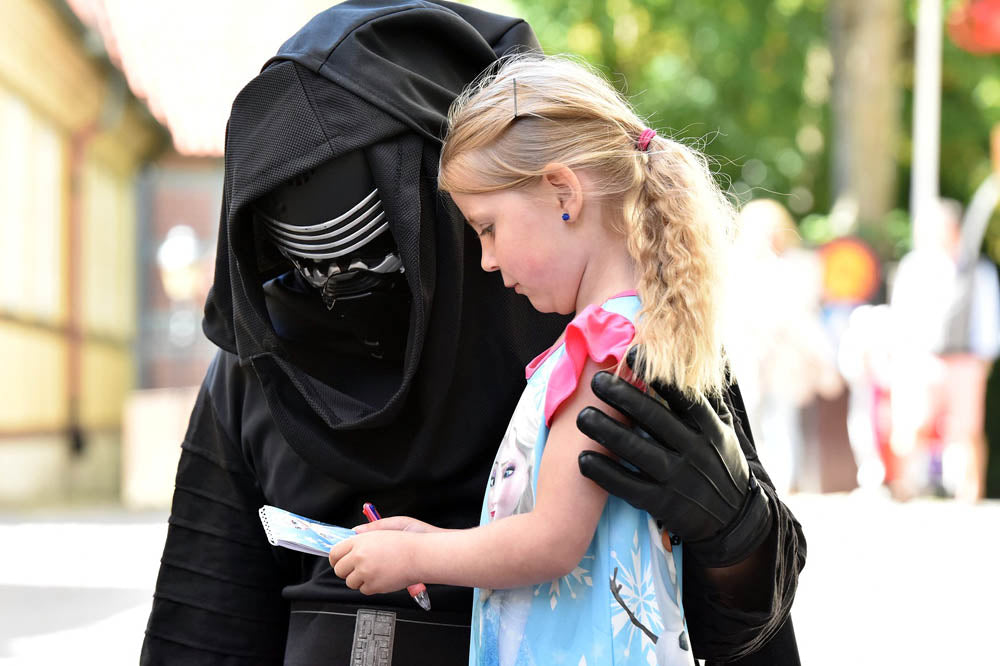TT Strange Times - A Staycation Summer - Have a marathon Star Wars movie day. Kylo Ren, though hellbent on galactic destruction, still has time for a quick chat and to check out this little girl's notes. Maybe they are detailed plans for a next generation Death Star?