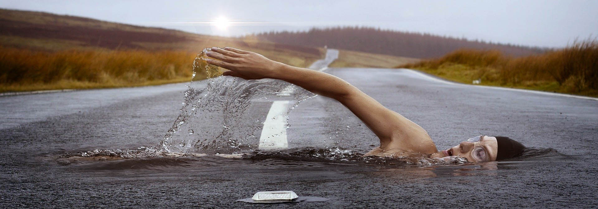 """TT Strange Times: Let's hope the weather this summer isn't bad enough to consider """"road swimming"""" as an acceptable sport!"""