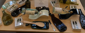 Items made out of wine bottle glass. Knife and fork set, serving platters, spoon rests, wine bottle holders.