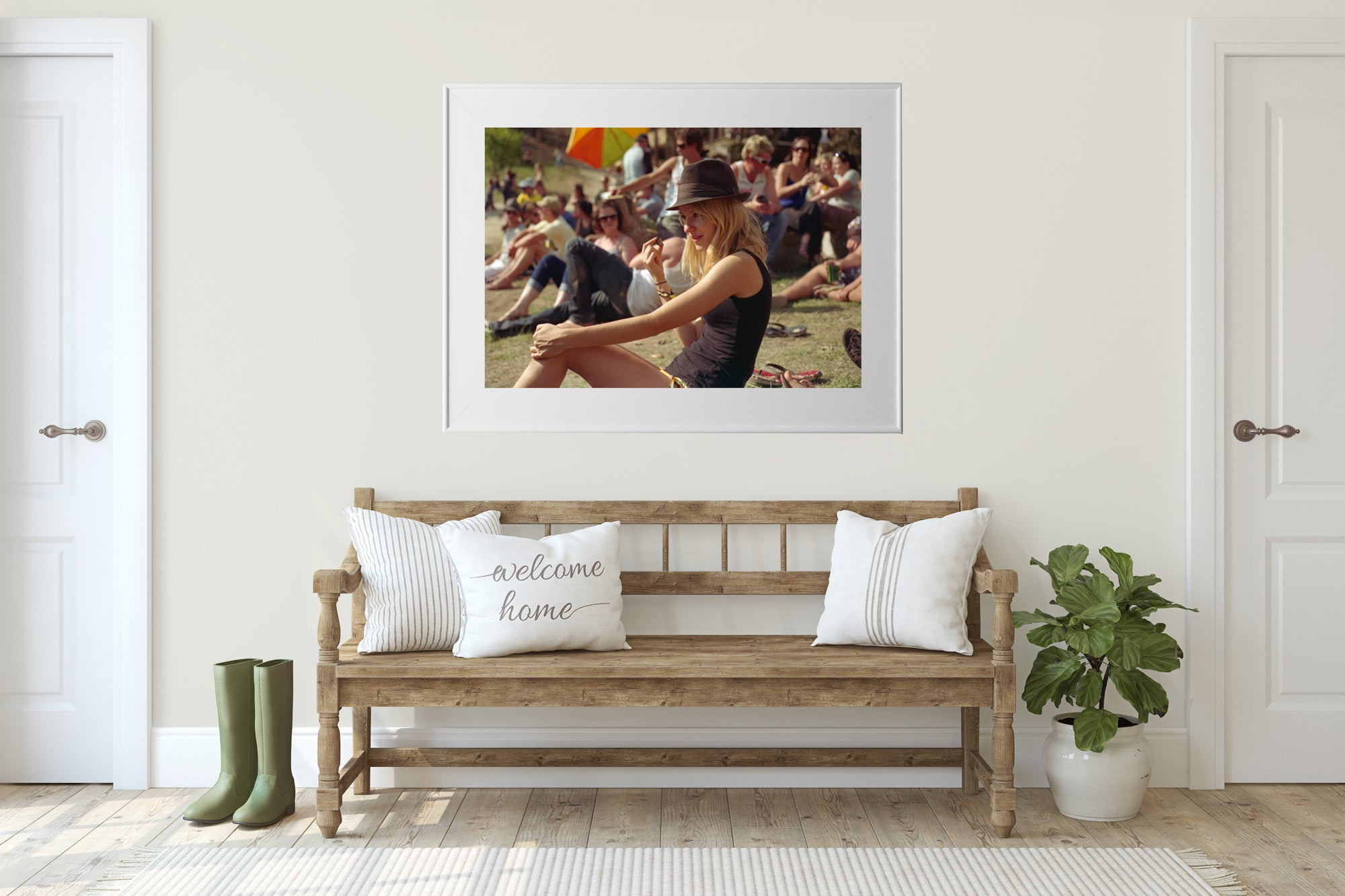 A photograph of a blonde haired girl with a pro pie hat sitting down & looking out at a music festival in the country. She is wearing coloured shorts & a black top. Artwork Prints wall art,  Melbourne travel ,Australia Photographic prints, music festival, Framed artwork, Australian,  Photography, Photography for sale, Film photography, Vintage photo style,  Interior design, Film photography, Pictures,  art, film photography,
