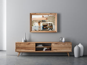 A Photo of two surfers putting their vintage longboards on the roof of an old Kombi van.  A young girl inside the Kombi smiling at the camera.  artwork, Prints, wall art, photographic prints,      prints, ocean, framed artwork, photography, film photography, vintage photo style,  Interior design, beach, buy art, photography art, buy art, Prints for sale, art prints, colour photography, sun, beach, sun baking, retro, interior design artwork, surfing, Kombi van, Malibu