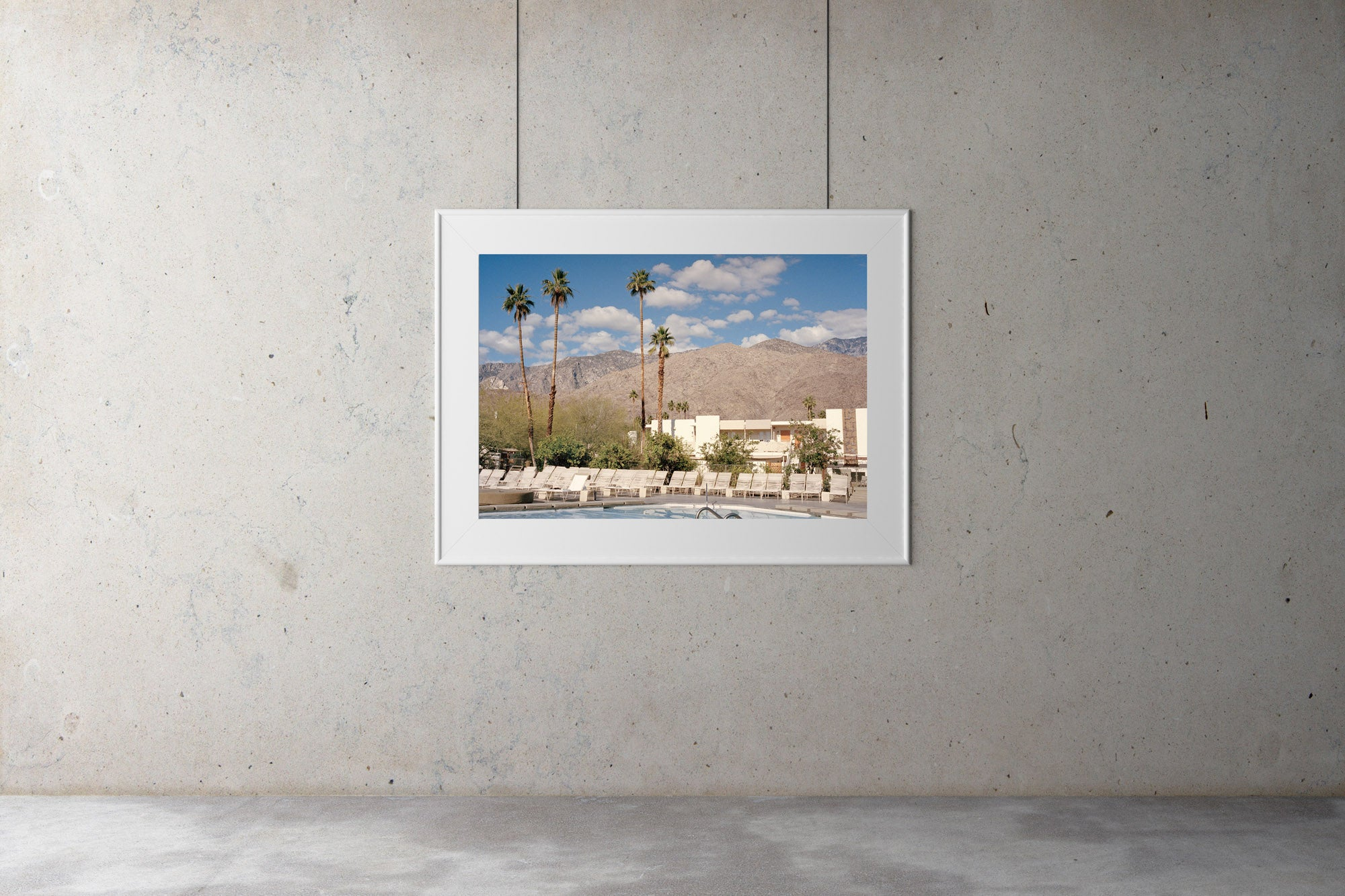 A photograph of a swimming pool looking out on palm trees & large mountains. Blue skies & clouds, Palm tree, USA, Artwork, Prints, wall art, California, Photographic prints, Ocean Palm Springs, Framed artwork, Photography,  Film photography, Vintage photo style,  Interior design, beach, buy Art, photography art, buy art, ace hotel, Prints for sale, art prints, colour photography, surfing, surfboard, Malibu, Malibu,  surfing, sun, beach, sun baking, mid century