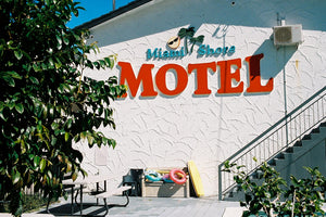 A photograph of a 1960's motel with a big red sign that says motel. Artwork, Prints, wall art, GoldCoast Queensland Australia, Photographic prints, Ocean Beach, buy artwork, buy prints Framed artwork, Beach Posters   Film photography, Vintage photo style,  Interior design, Film photography Pictures sun & surf ,photography art