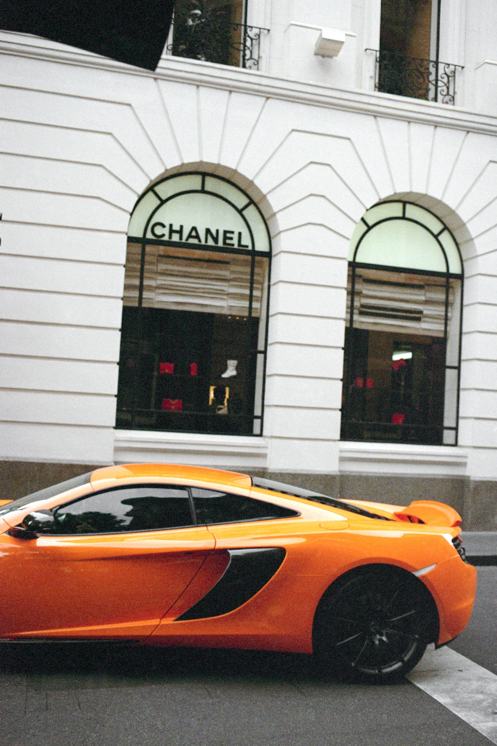 A yellow Lambourgini sits outside the Chanel store in Melbourne Australia