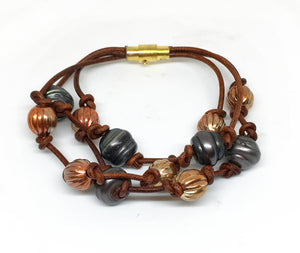 baroque black pearl and corrugated flame painted copper bead triple strand leather bracelet with magnetic clasp