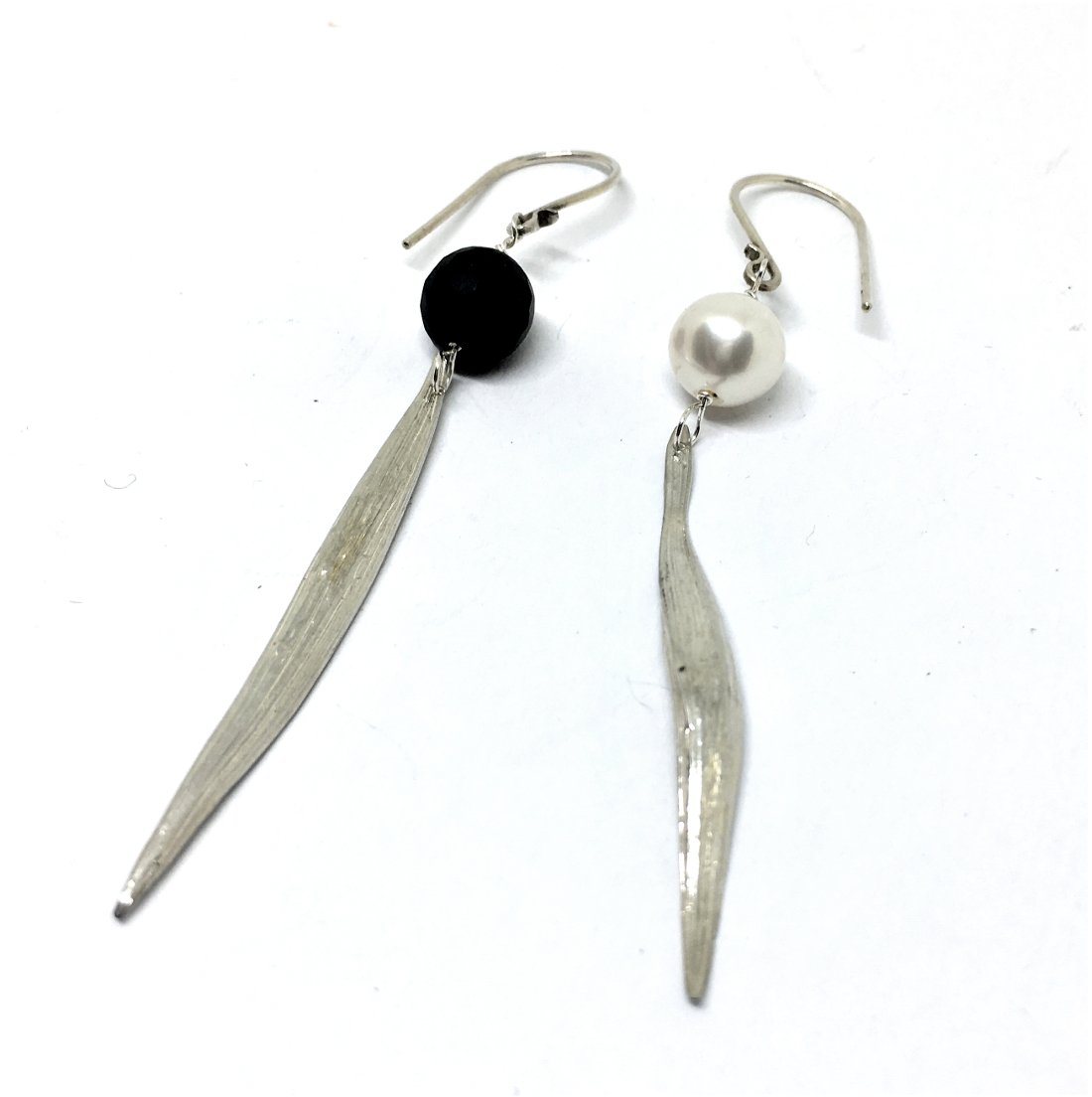 Asymmetrical Onyx and freshwater white pearl earrings with bamboo leaf drops