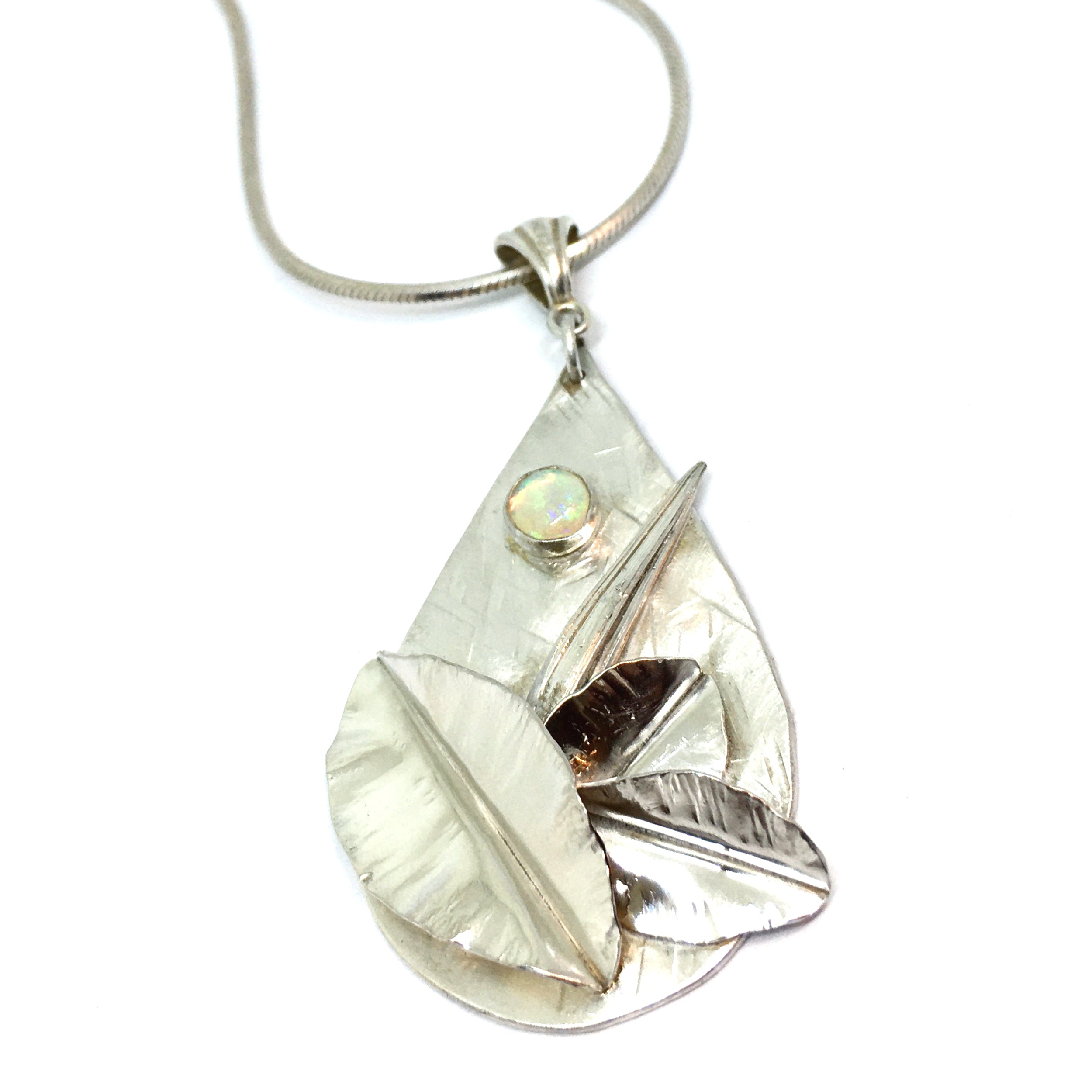 Botanical Opal Pendant with fold formed leaves and mitsuro hikime in sterling silver on snake chain