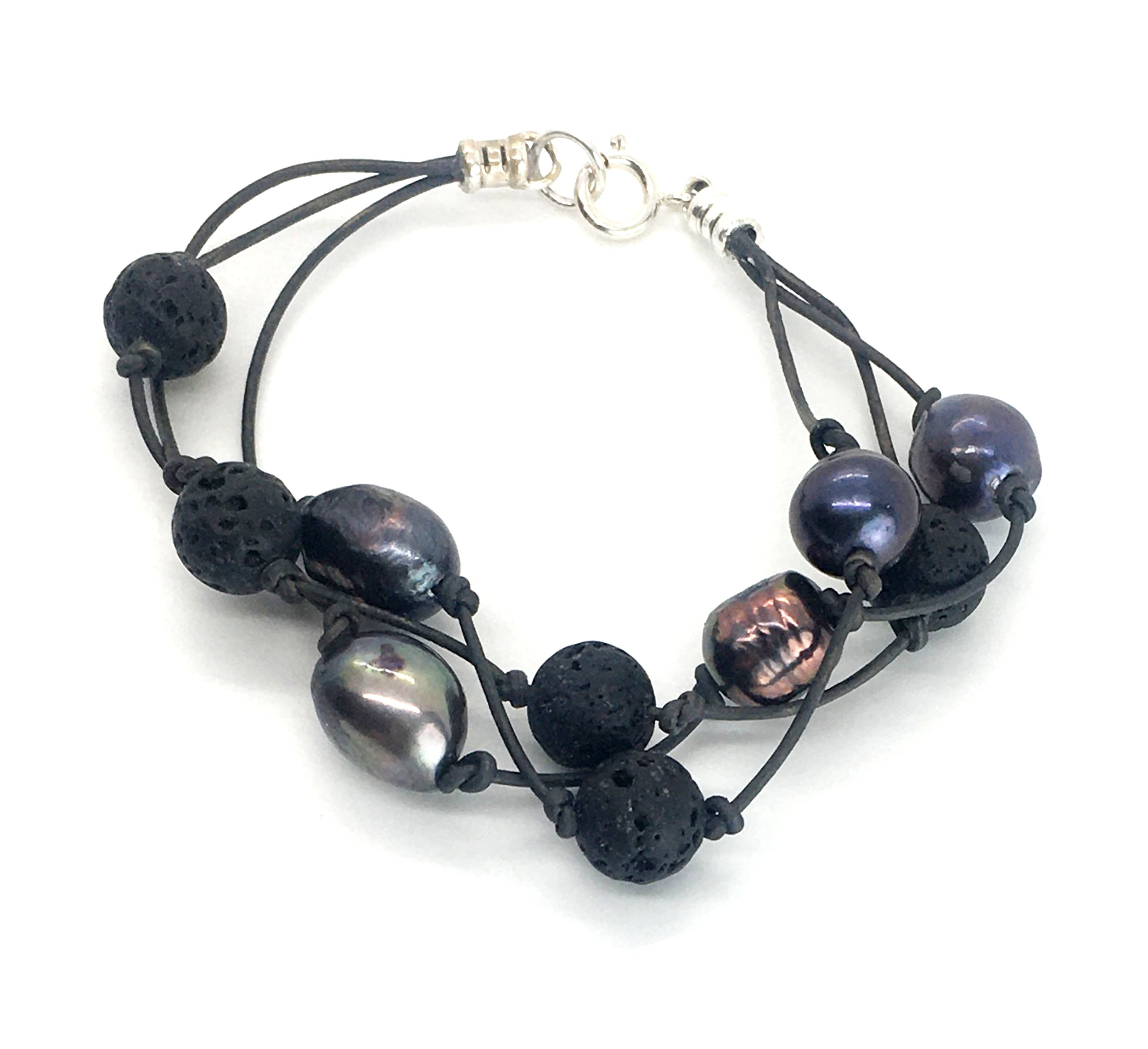 Peacock freshwater pearl and lava three strand black leather bracelet