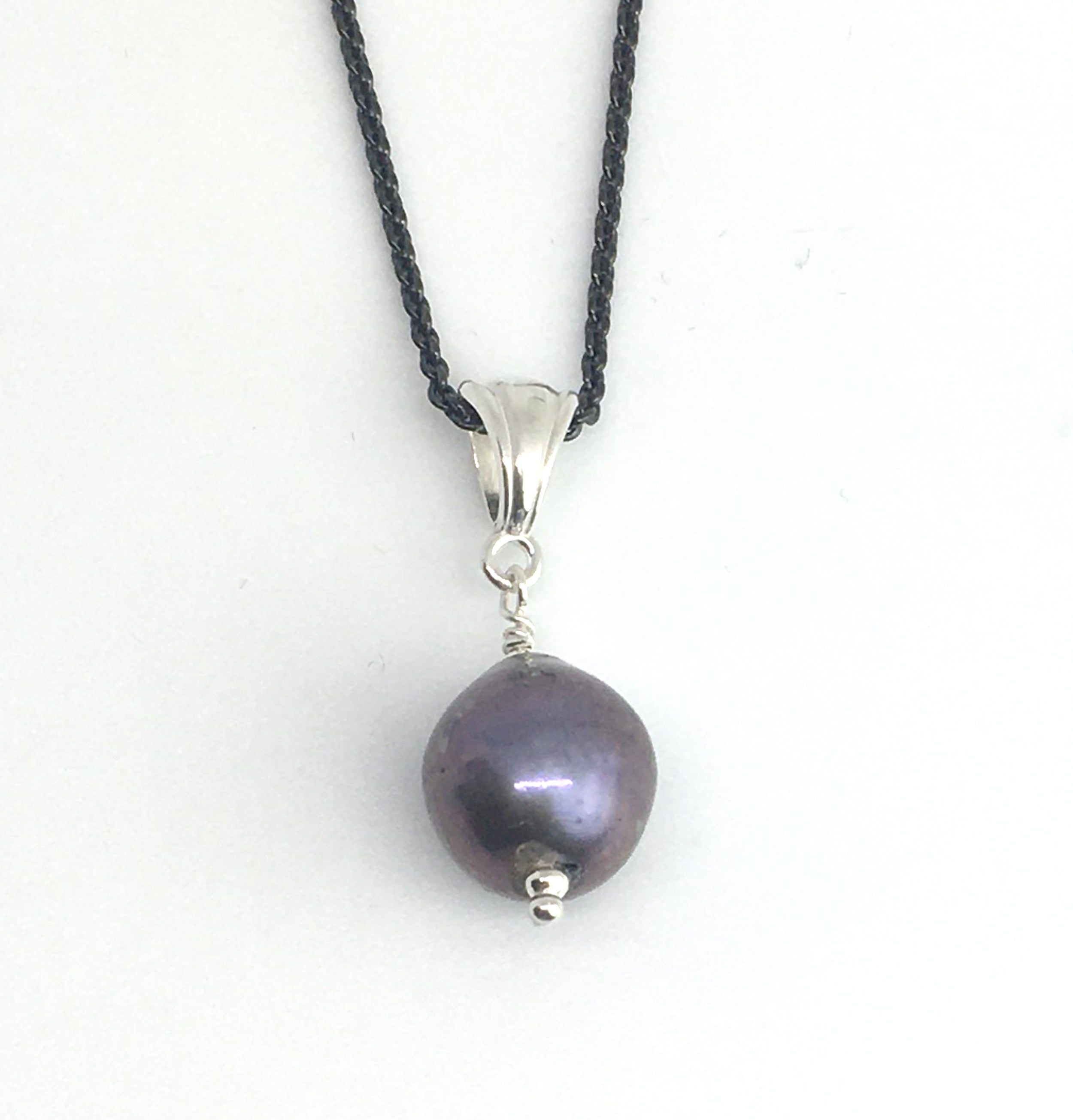 single freshwater purple peacock pearl pendant necklace on black silver chain