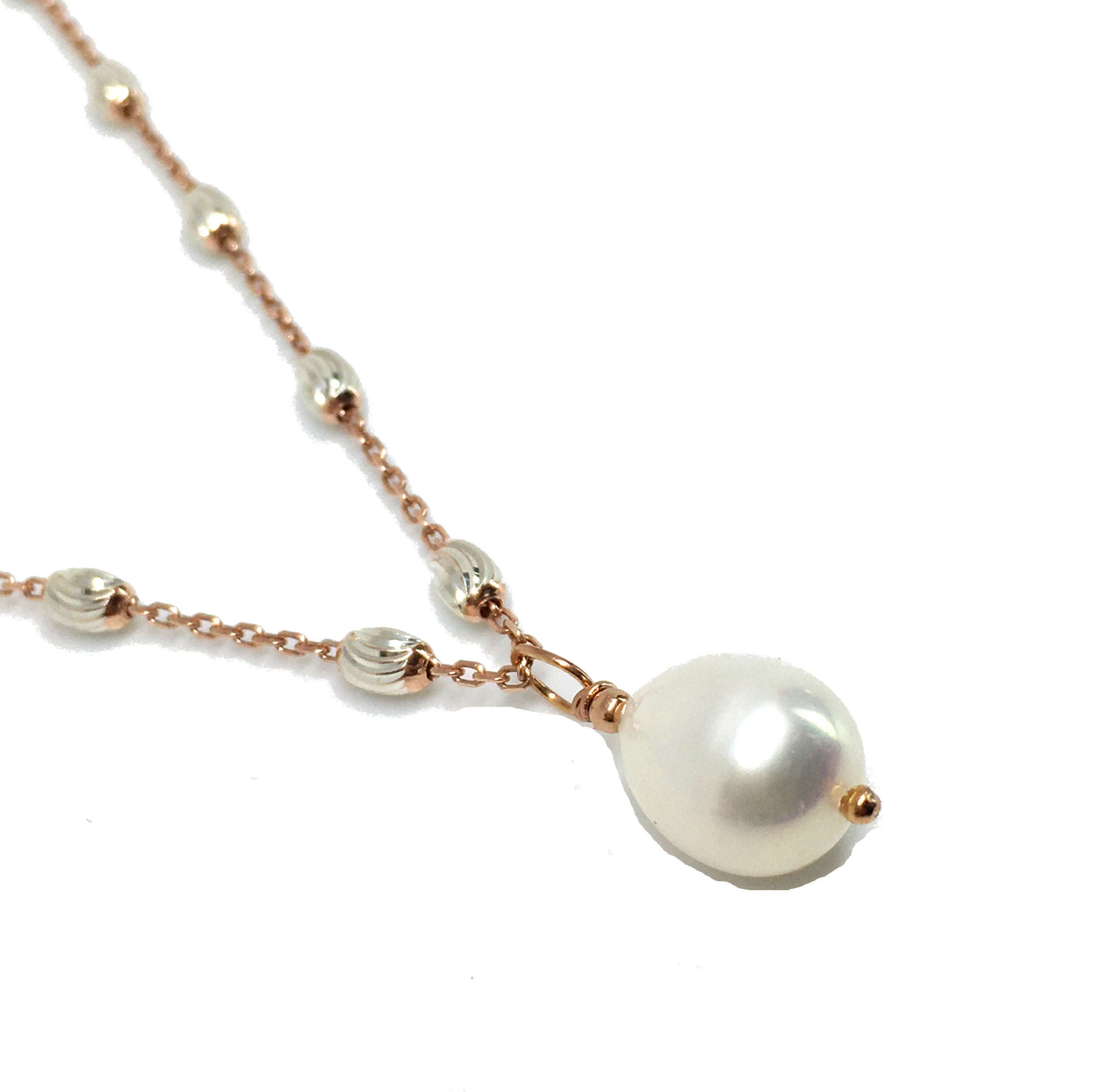 pear shaped white pearl pendant necklace on rose gold filled station chain necklace
