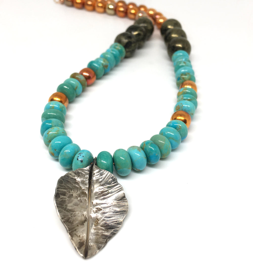kingman turquoise, apache gold gemstone and flame painted copper bead necklace with fold formed silver leaf