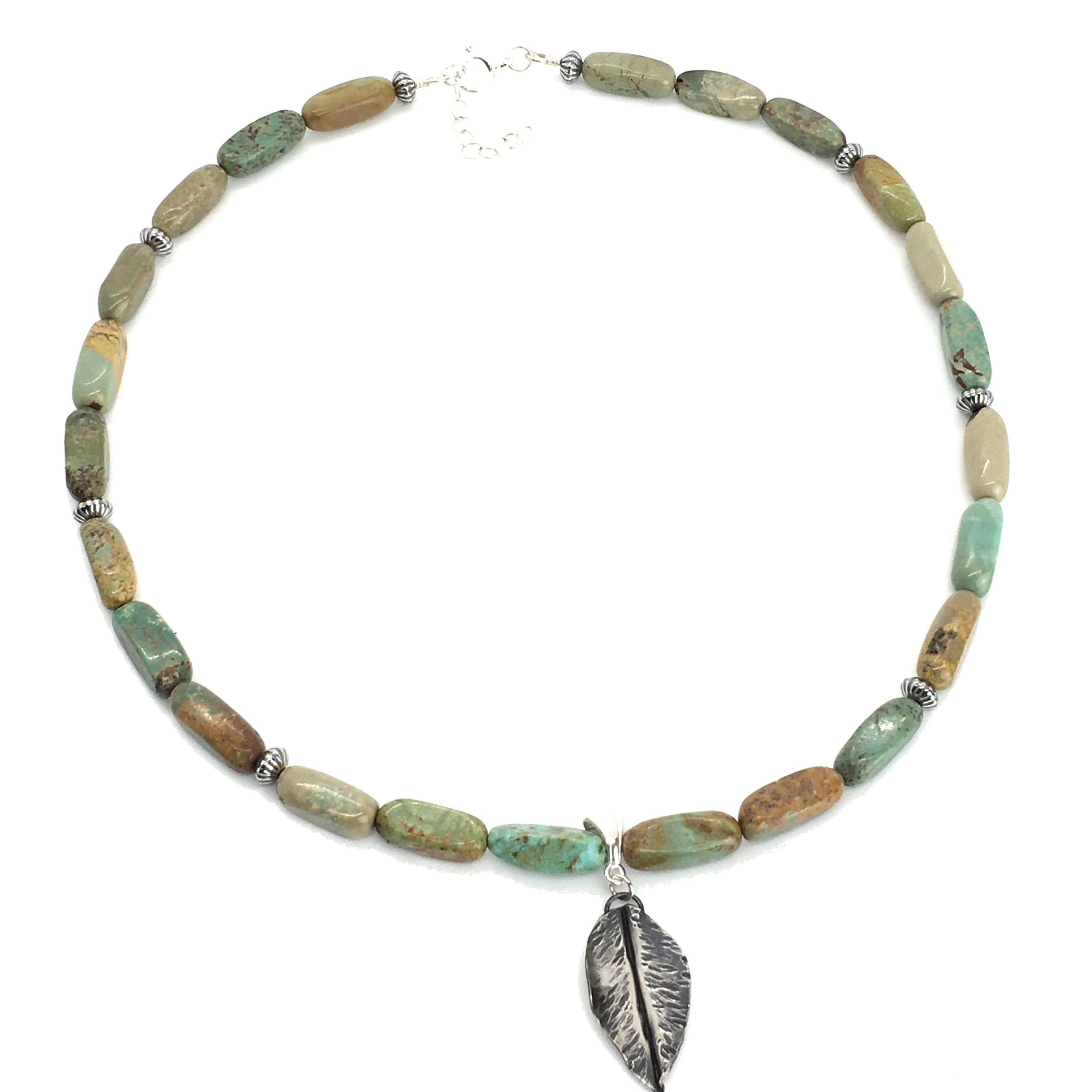 turquoise necklace with silver fold formed leaf pendant