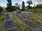 Composite Mats used on site with a small bulldozer