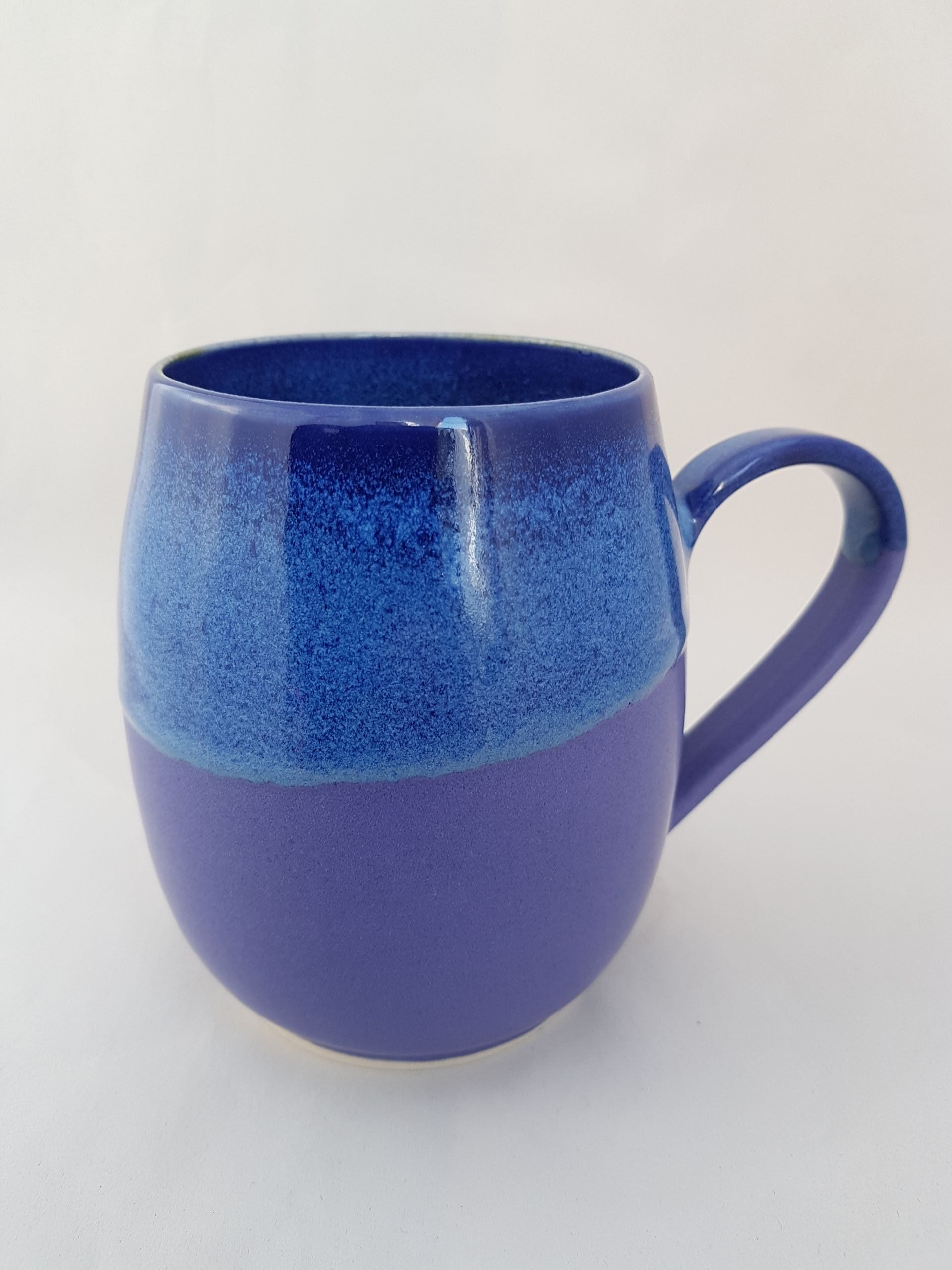 A satiny smooth lilac glaze with warm blue rim
