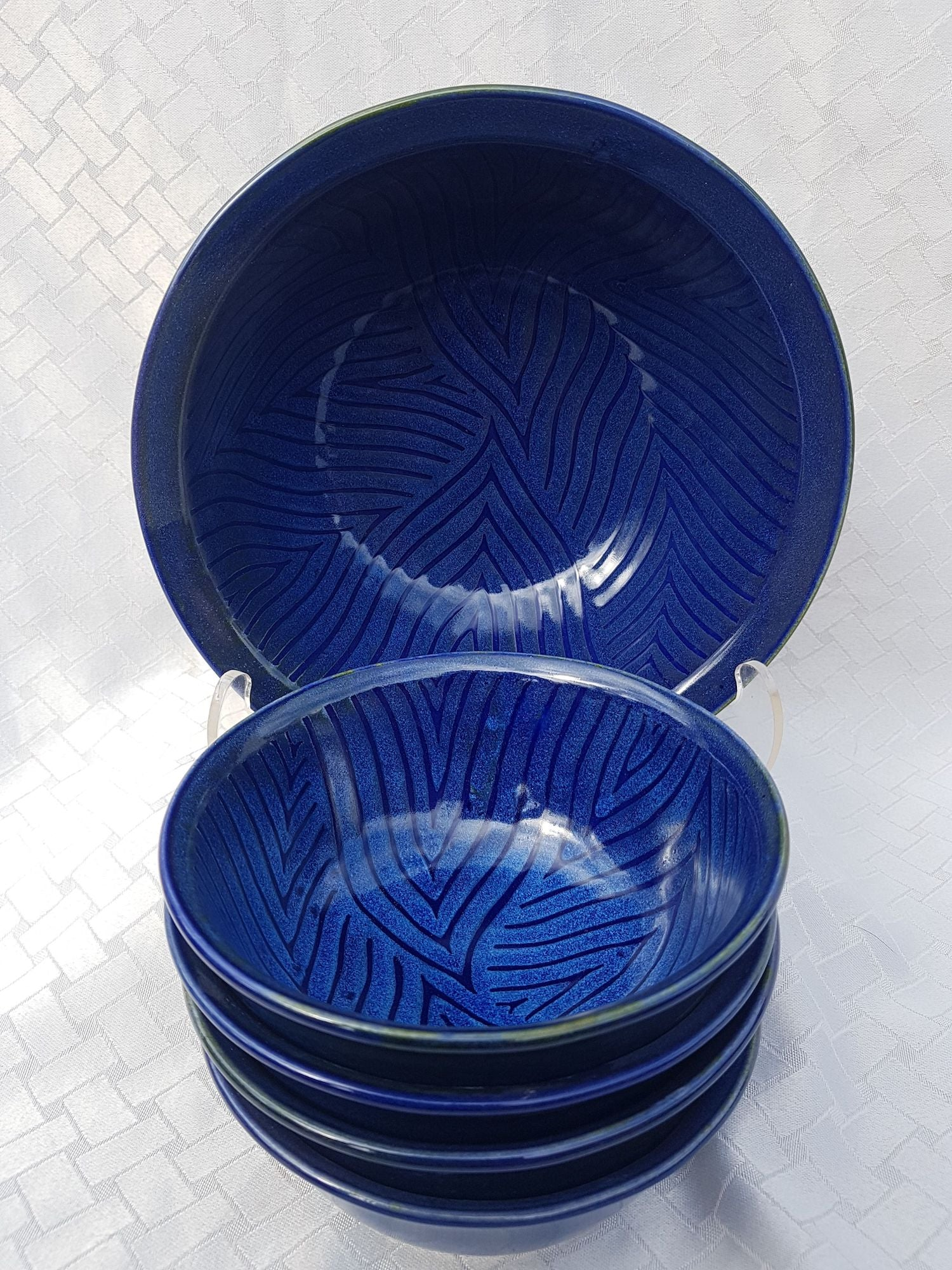 Pemberton Sky:  A hand-painted leafing pattern with a textured finish in a two toned blue glossy finish