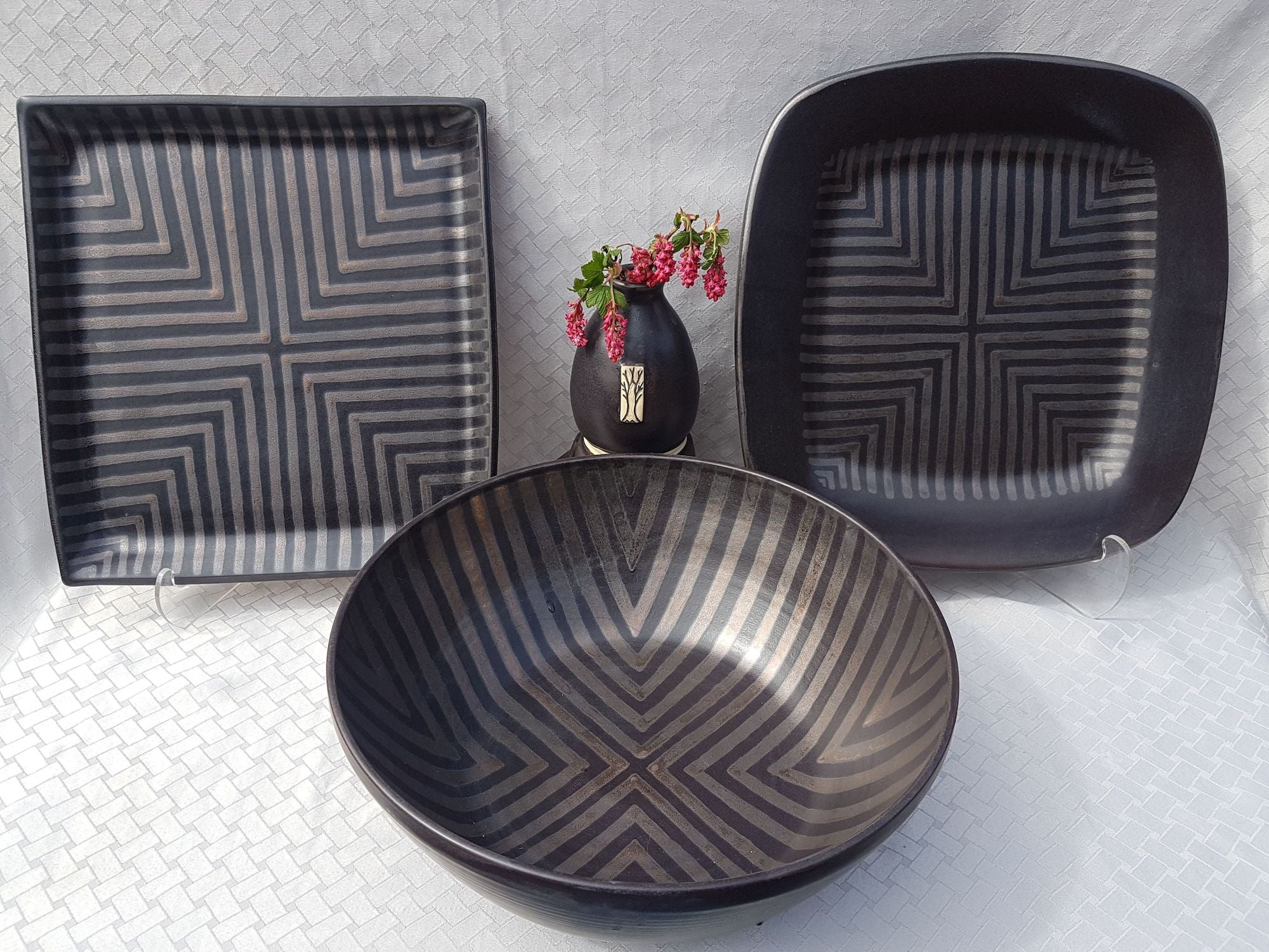 Semi-matte charcoal glaze with a hand-painted gold chevron pattern