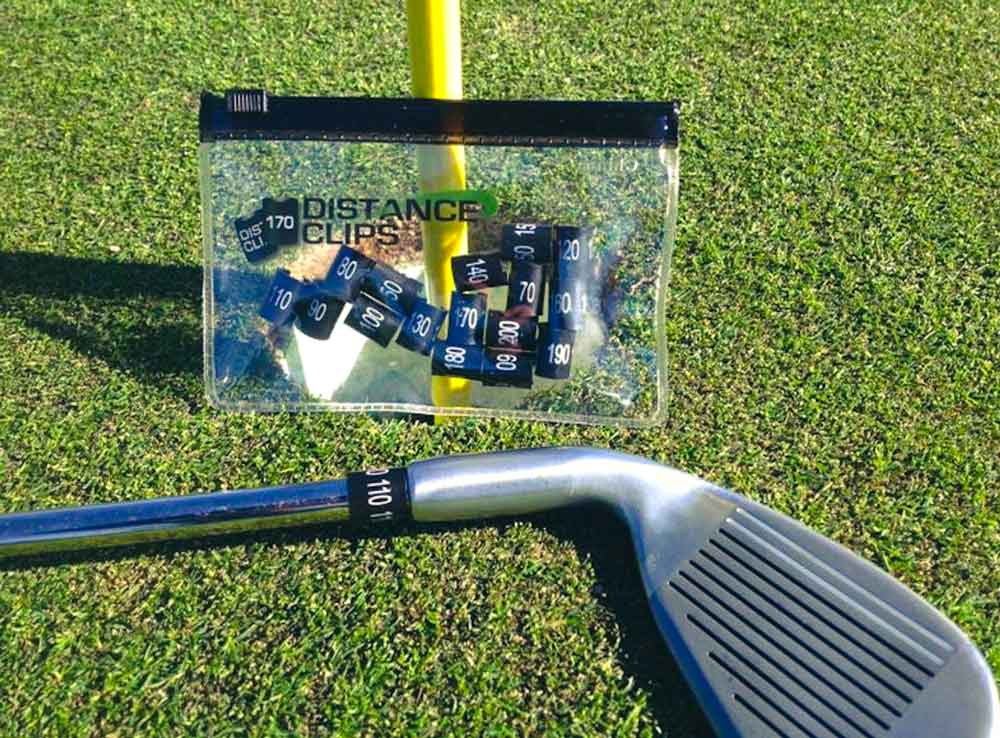 Distance clips shown on the golf club.