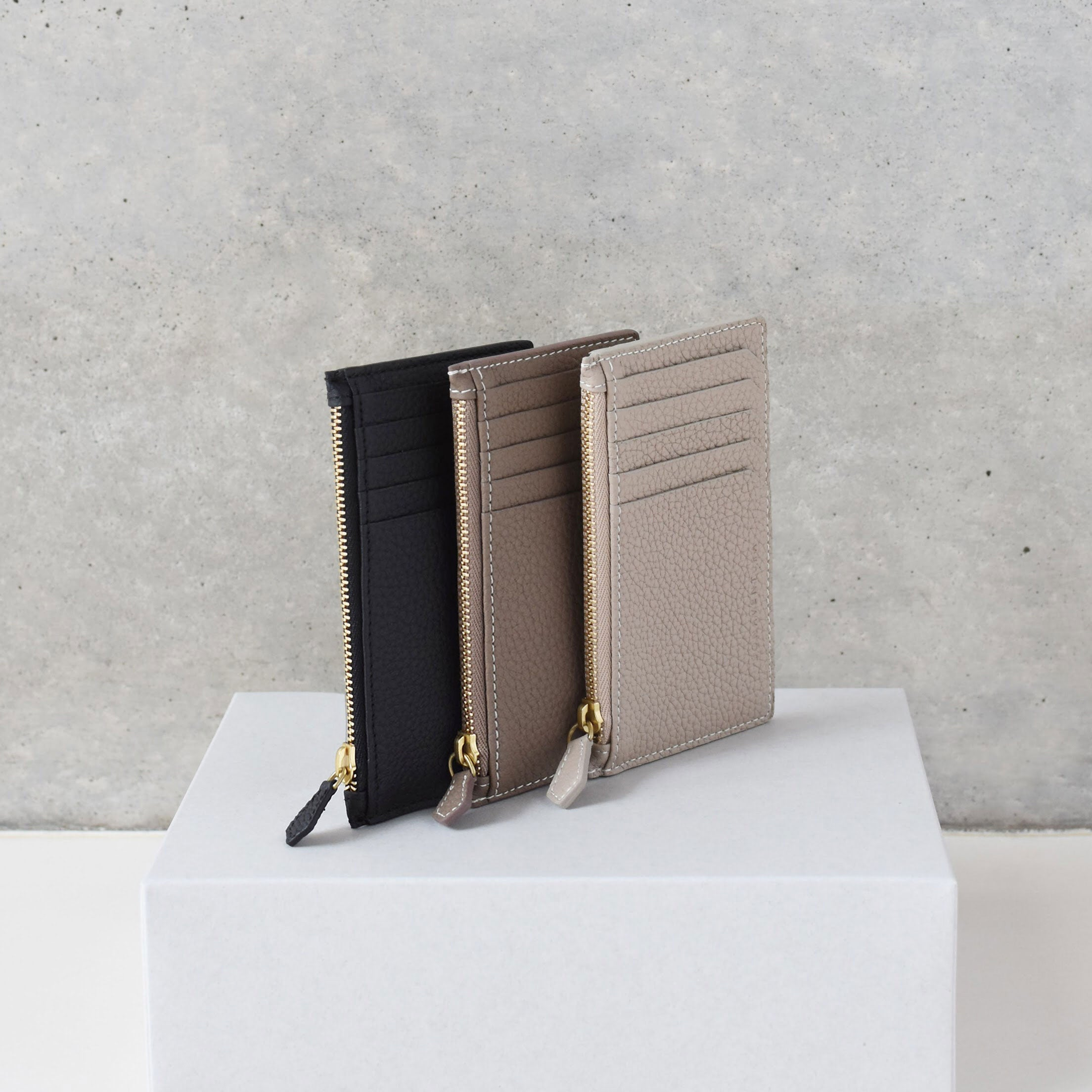 Mini zip wallet shrink