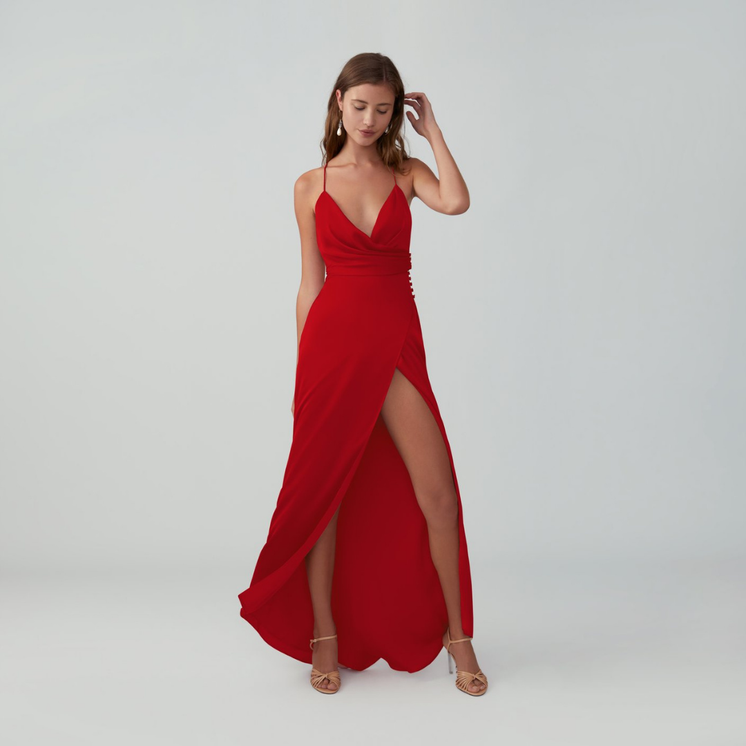 Woman in red matte satin front split dress front.