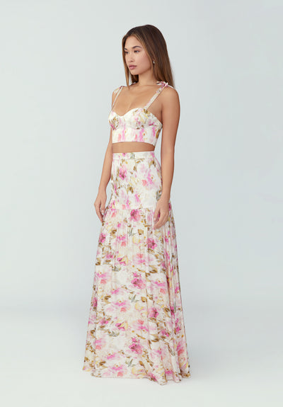 Woman in two piece floral pink dress side.