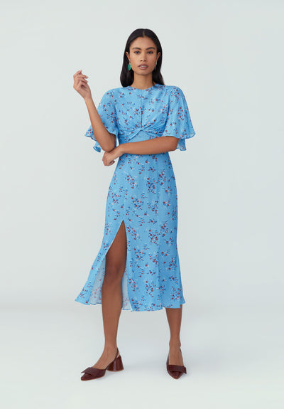 Woman in sky blue floral shirt dress front.