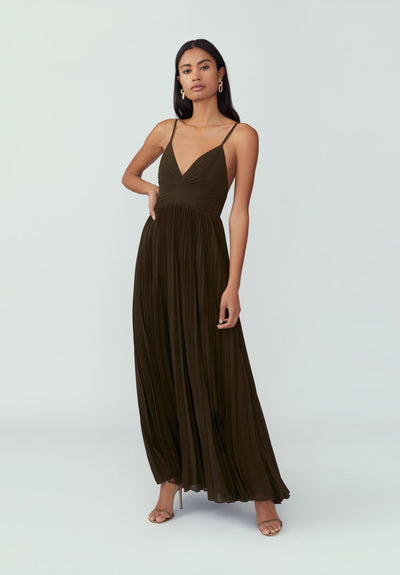 Woman in dark juniper fully pleated A-Line silhouette dress front.