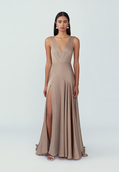 Woman in dark tan maxi train dress front.