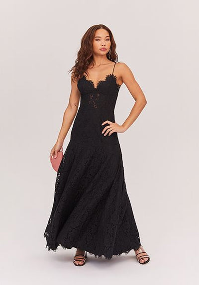 Woman in black corded lace dress front.