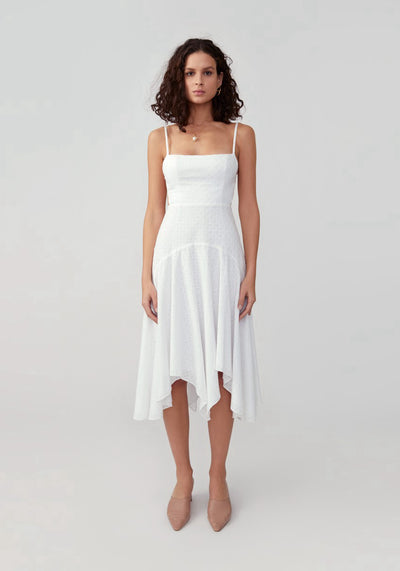 Woman in ivory fit and flare dress front.