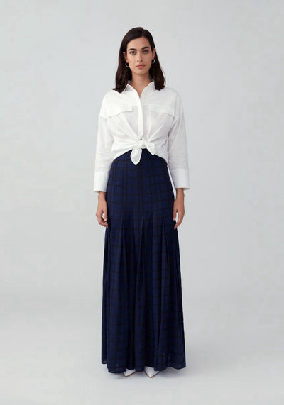 Woman in navy weave maxi skirt front.
