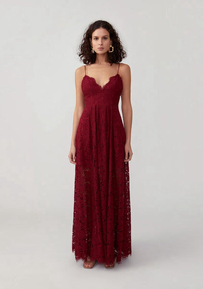 Woman in burgundy corded lace full dress front.