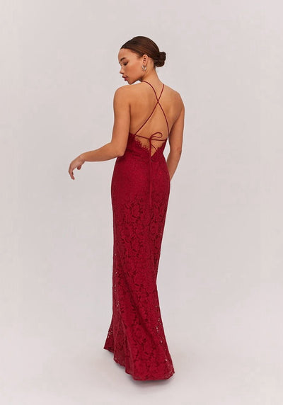 Woman in burgundy lace dress back.