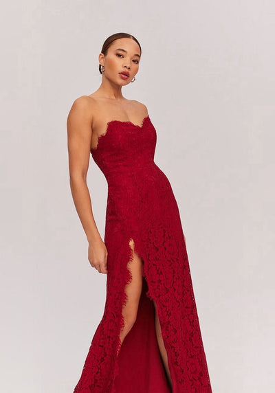 Woman in burgundy strapless lace maxi dress front.