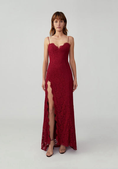 Woman in burgundy lace maxi dress front.