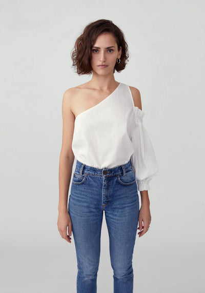 Woman in white one sleeve top front