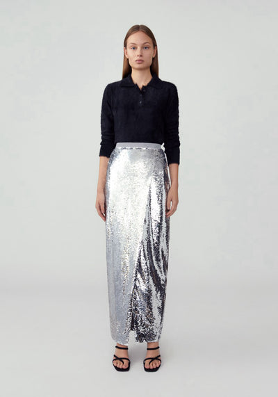 Woman in glossy sequin silver fixed wrapped pencil skirt front.