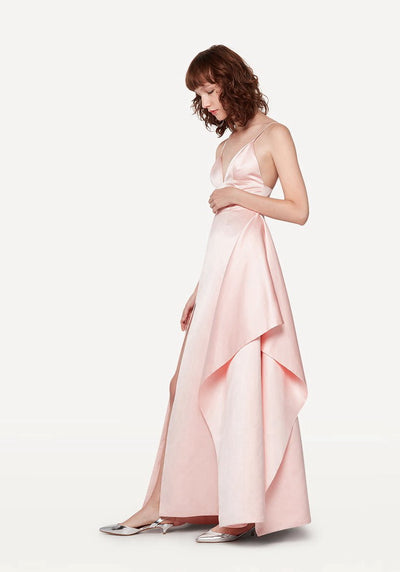 Woman in pale pink tri-cup A-line maxi dress side.