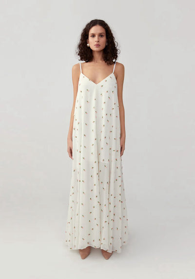 Woman in floral ivory loose slip dress front.