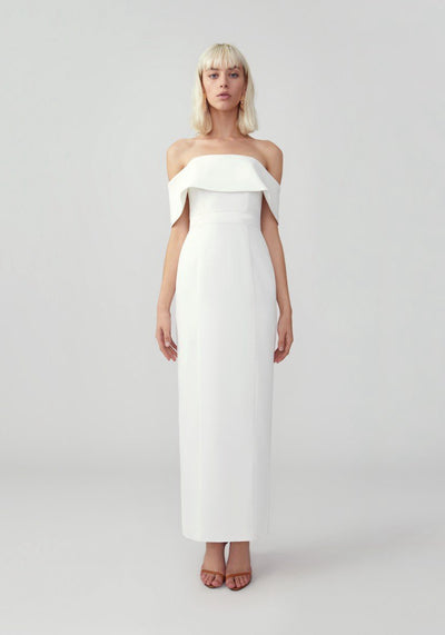 Woman in ivory off shoulder column dress front.
