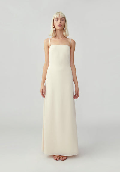 Woman in champagne slip dress front.
