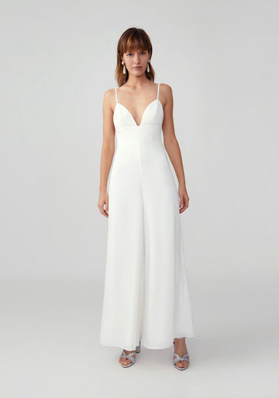 Woman in ivory bust cup and wide leg pant jumpsuit front.