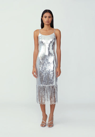 Woman in silver sequin fringe hem dress front.