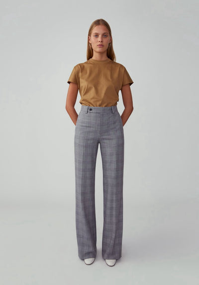 Woman in plaid grey straight leg pant front.