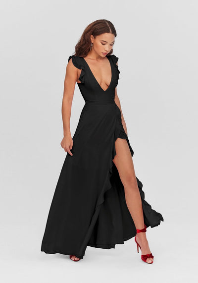 Woman in black maxi wrap dress front.