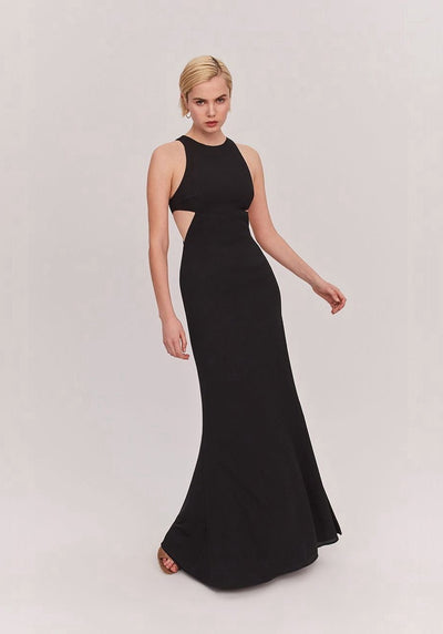 Woman in black side cutout maxi dress front.