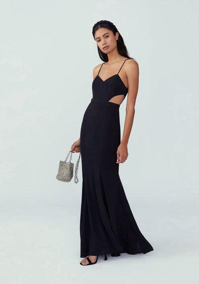 Woman in black side cutout mermaid dress front.