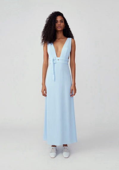 Woman in blue frost plunging v neckline with double buckled waist strap dress front.