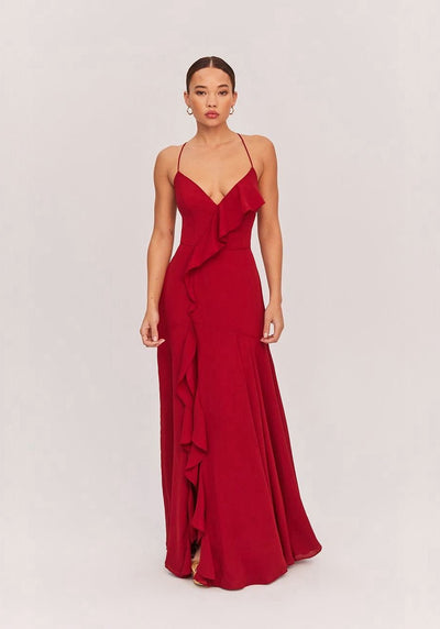 Woman in burgundy crossfront maxi dress front.
