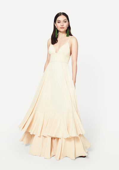 Woman in champagne double ruffle hem maxi dress front.