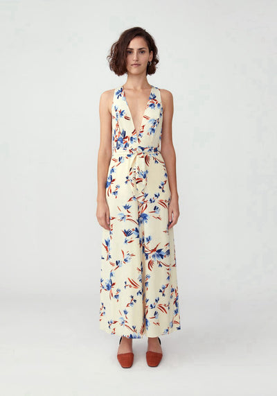 Woman in ivory floral printed jumpsuit front.